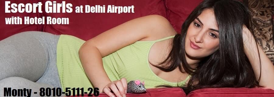 delhi airport escort model alluring sexy pose in a green vest.